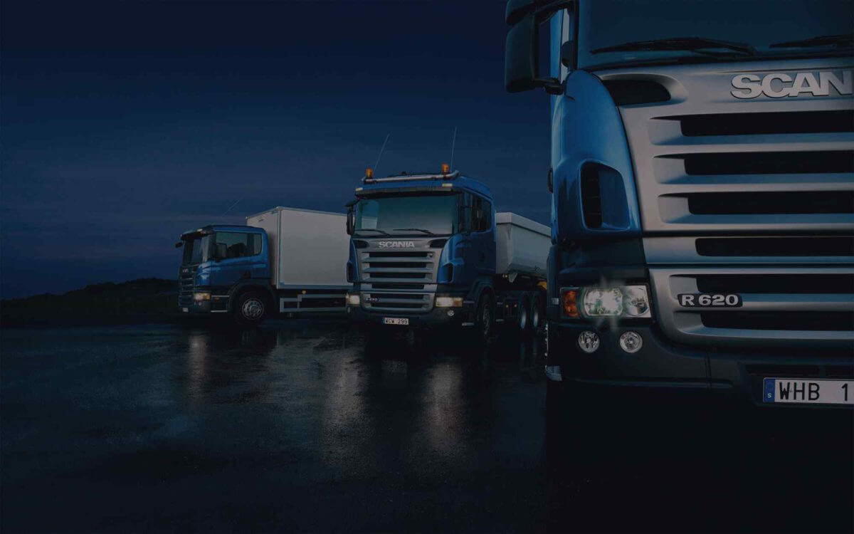 Dark-Three-trucks-on-blue-background-1200x750.jpg